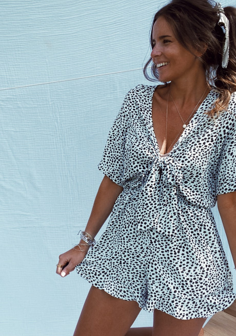 White Snowy jumpsuit with black spots