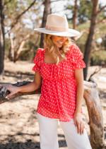 Coral Syra blouse with polka dots